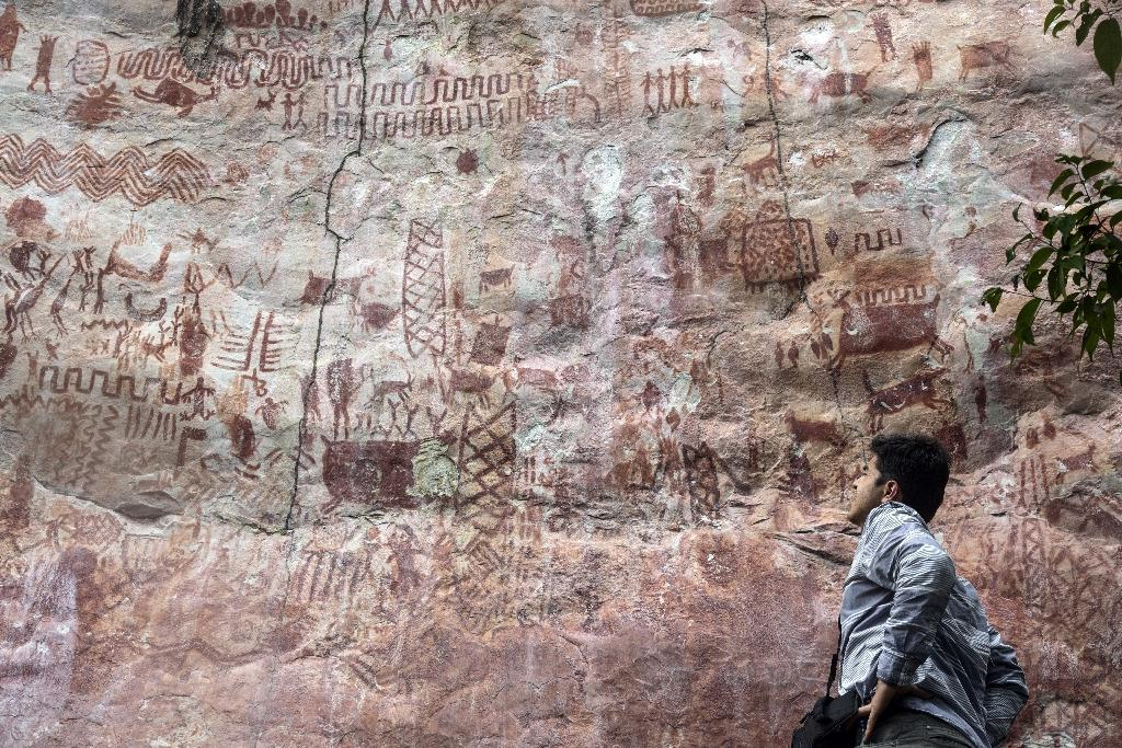 Since the 2016 peace accord that ended the war with FARC guerillas, adventurers have ventured forth once again to try to decipher the secrets of the ritual drawings (AFP Photo/GUILLERMO LEGARIA)