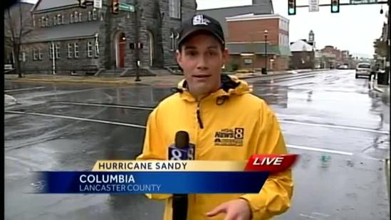 Car slides through Hurricane Sandy live shot