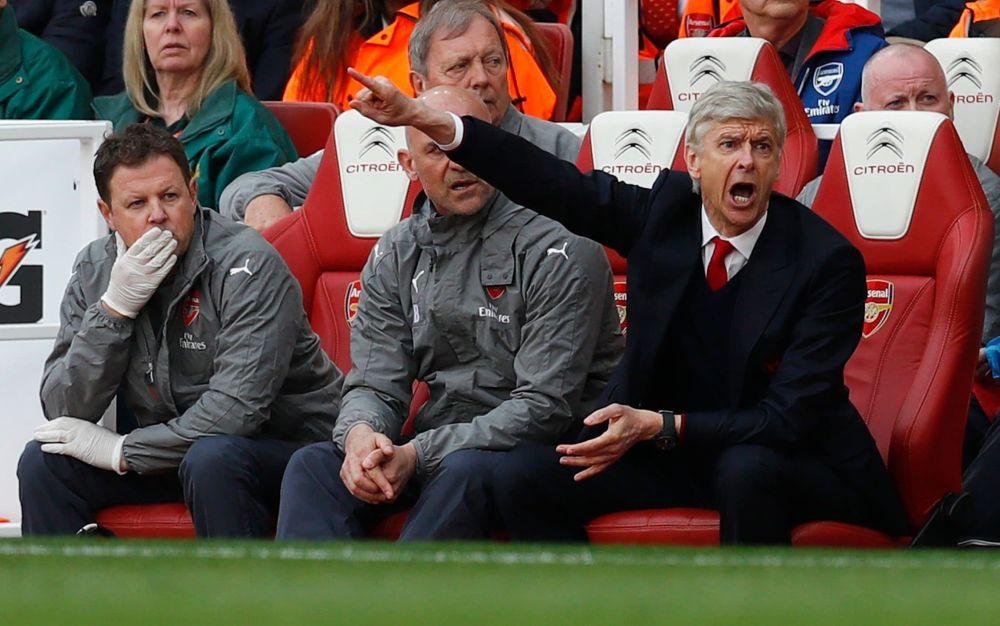Arsene Wenger urges his team on - REUTERS
