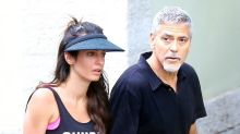 George and Amal Clooney hold hands after tennis match in Italy