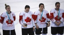 Disappointed in loss, Canadian player removes silver medal during presentation