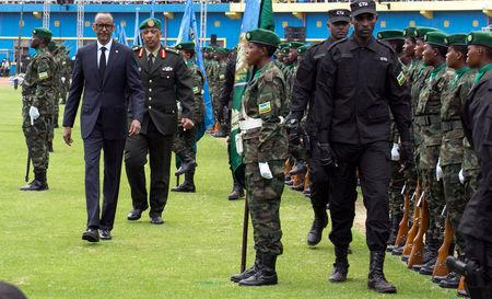 Rwanda's President-elect Paul Kagame (C) inspects the guard of honour before his swearing-in ceremony at Amahoro stadium in Kigali, Rwanda, August 18, 2017. REUTERS/Jean Bizimana