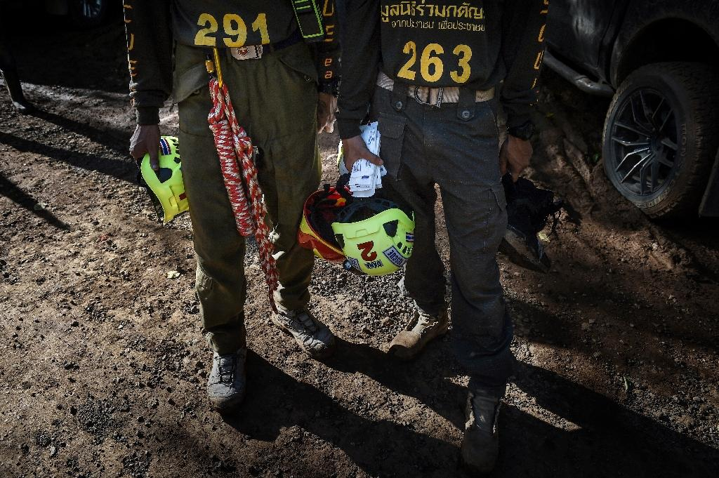 """The rescue effort started almost two weeks ago after the """"Wild Boars"""" team went into the cave in northern Thailand after football practice (AFP Photo/Lillian SUWANRUMPHA)"""