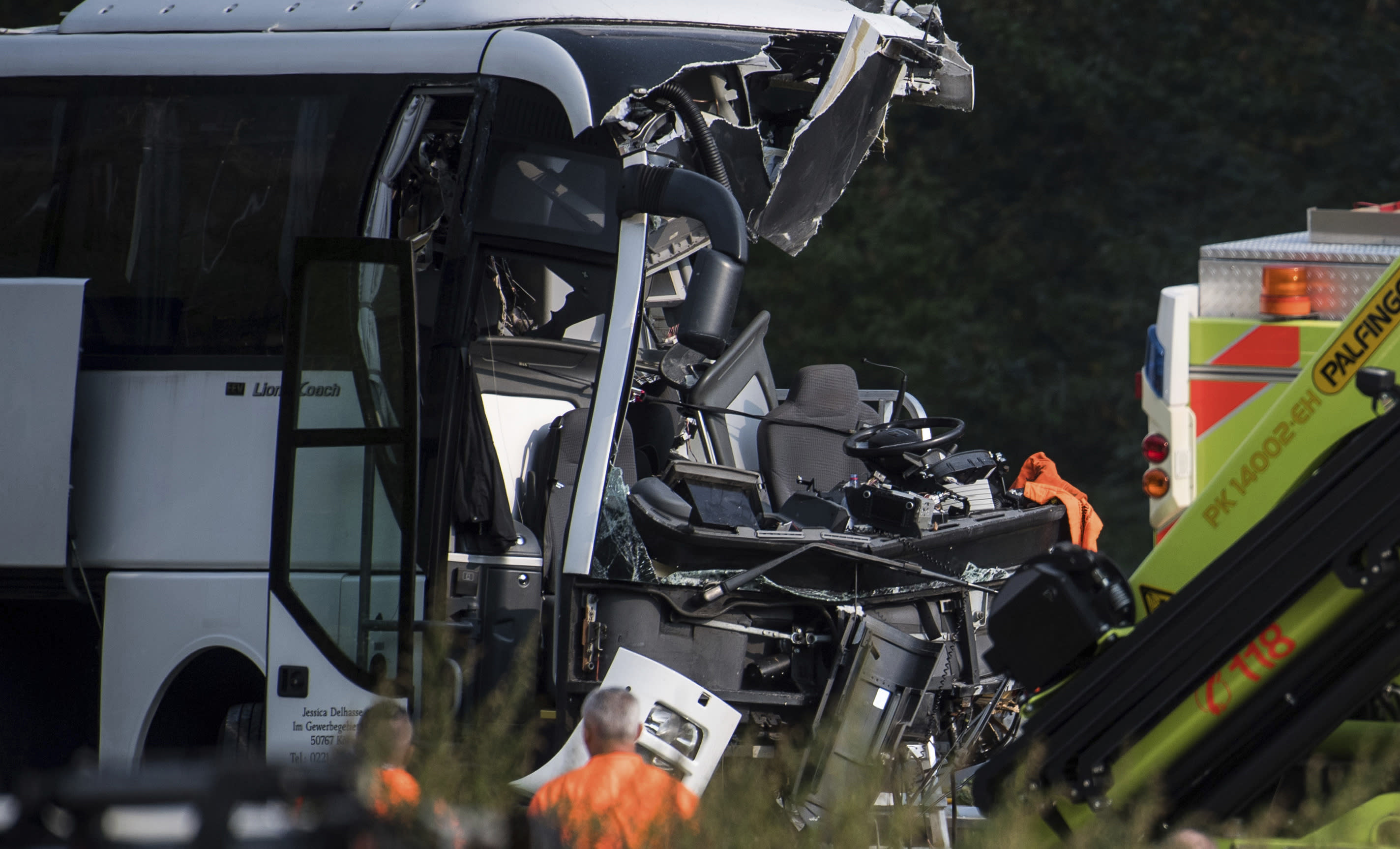 The accident site of a bus that crashed into signal post on the highway A2 in Sigirino, canton of Ticino, Switzerland, Sunday, Oct. 14, 2018. The A2 highway between Rivera and Lugano-North in is closed to the south. Several people were injured in the accident. (Gabriele Putzu, Ti-Press/Keystone via AP)