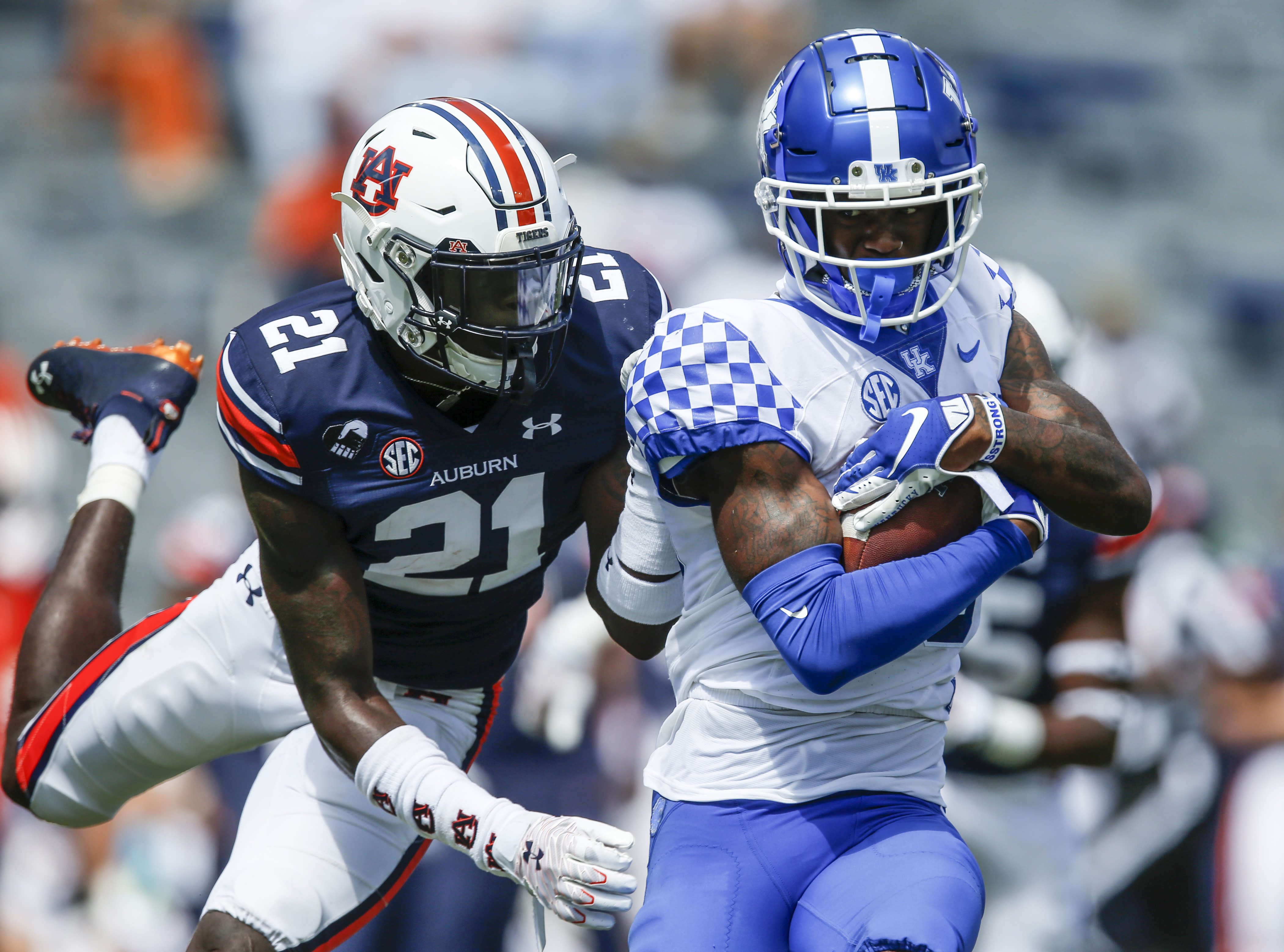 Kentucky wide receiver Allen Dailey Jr. (89) is tacked by Auburn defensive back Smoke Monday (21) after a reception during the second quarter of an NCAA college football game on Saturday, Sept. 26, 2020, in Auburn, Ala. (AP Photo/Butch Dill)