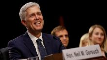 Trump appointee Gorsuch energetic in first U.S. high court arguments