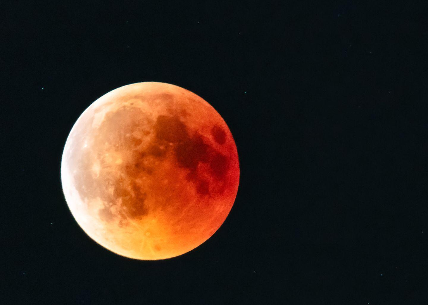 <p>A blood moon occurs when the moon dips low in the sky, through Earth's shadow, which casts a reddish glow across the satellite.</p>