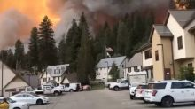 California wildfire burns at least two dozen homes in small mountain town