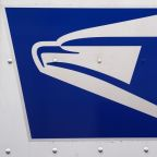 U.S. Postal Service chief warns of 'dire' finances, adopts manager hiring freeze