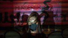 PHOTOS: Layered portraits of Hong Kong's masked protesters