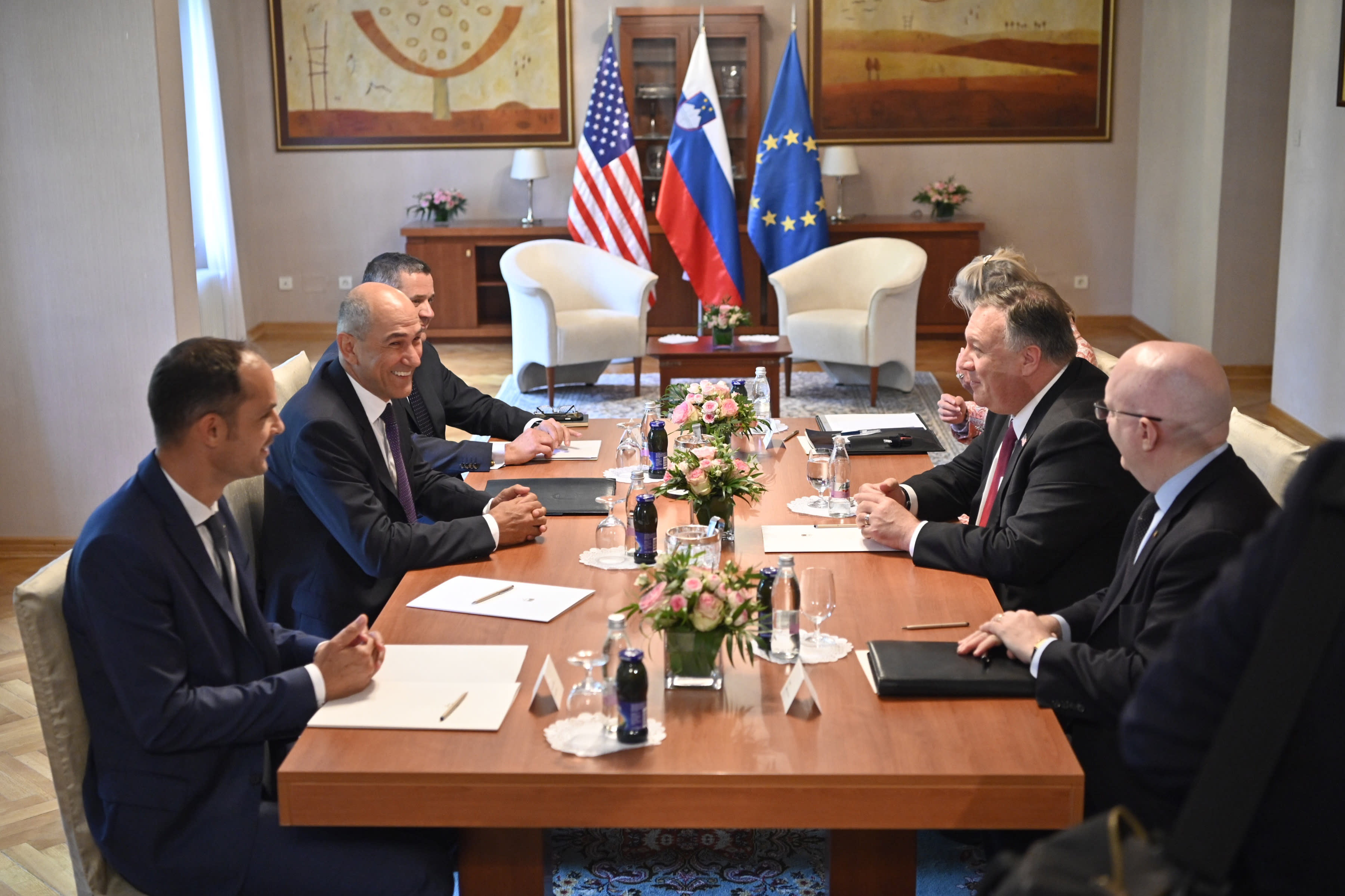 Slovenian Prime Minister Janez Jansa, second left and US Secretary of State Mike Pompeo , second right take part in a meeting in Bled, Slovenia, Thursday, Aug. 13, 2020. Pompeo is on a five-day visit to central Europe with a hefty agenda including China's role in 5G network construction. (Jure Makovec/Pool Photo via AP)