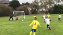 Watch this soccer dad hilariously try to help his goalie make a save