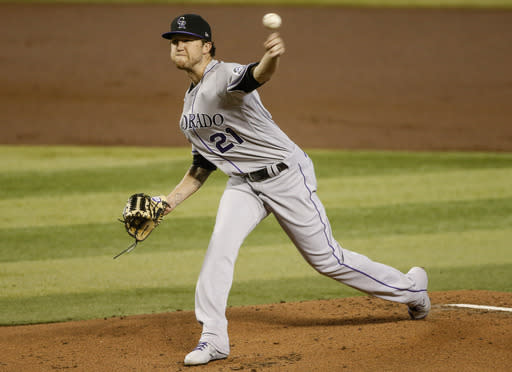 Colorado Rockies' Kyle Freeland delivers a pitch against the Arizona Diamondbacks during the first inning of a baseball game Sunday, Sept. 27, 2020, in Phoenix. (AP Photo/Darryl Webb)
