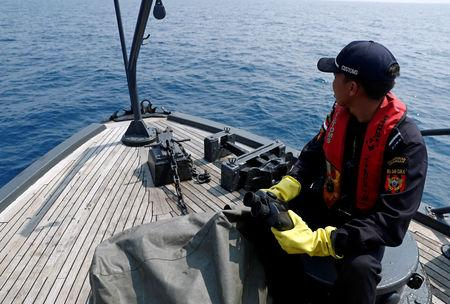 FILE PHOTO: Indonesian customs officers patrol at a search area for Lion Air flight JT610 in Karawang waters