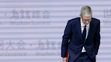 Tim Cook says Apple told users it was slowing their iPhones, but adds, 'I don't think a lot of people were paying attention' (AAPL)