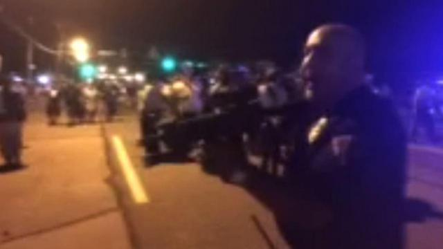 Officer Suspended for Pointing Gun at Ferguson Protester