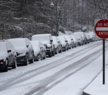 Schools shut, flights canceled as storm sweeps U.S. Midwest, East Coast