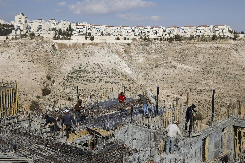 Palestinian labourers work on a construction site in the Israeli settlement of Maale Adumim, east of Jerusalem, on January 22, 2017 (AFP Photo/MENAHEM KAHANA)