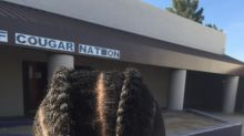After a boy with braided hair violated his dress code, his mom switched schools