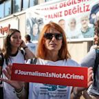 Turkish journalists defiant as they begin trial on terrorism charges