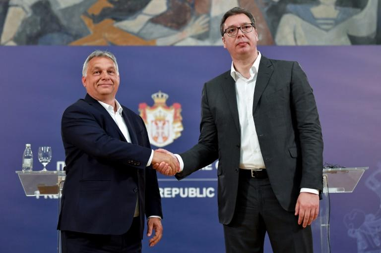 Serbian President Aleksandar Vucic (R) has deftly brought the media to heel using the same 'illiberal toolbox' as Hungary's Viktor Orban, according to the US-based Freedom House (AFP Photo/Andrej ISAKOVIC)