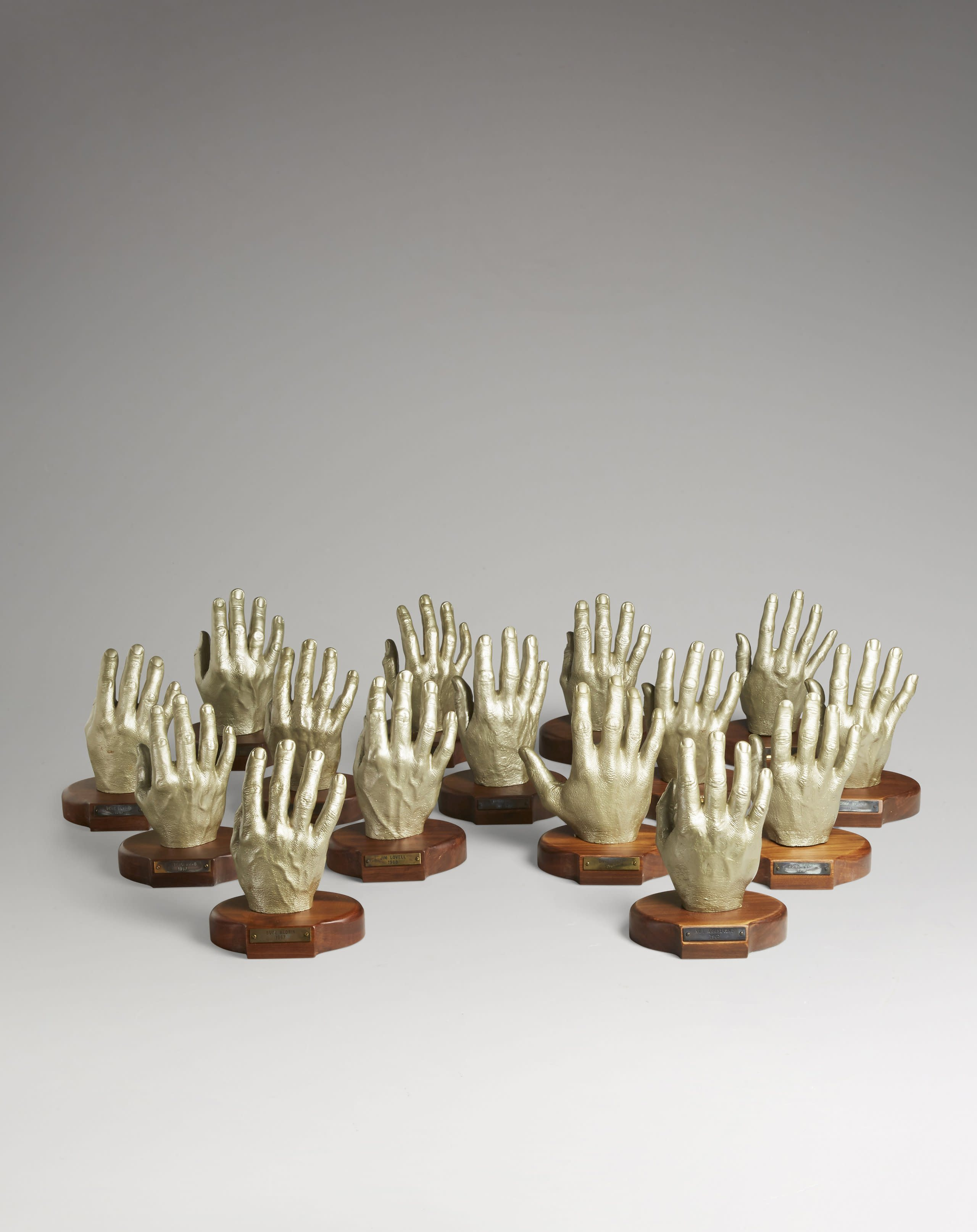 A collection of plaster casts of the right hands of 15 NASA astronauts, including Neil Armstrong and Buzz Aldrin. The molds were used to make each astronaut's space suit gloves.
