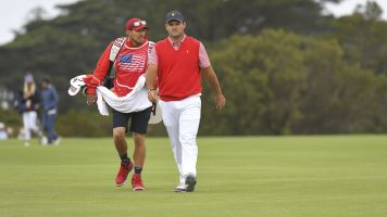 Reed's caddie punches fan at Presidents Cup