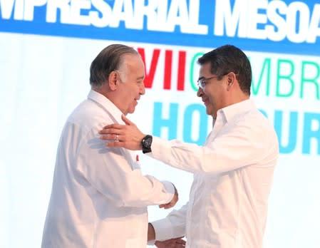 Mexican businessman and Vice Chairman of the Board of Grupo Modelo Valentin Diez Morodo and Honduras President Juan Orlando Hernandez shake hands during the XVII Tuxtla Summit in San Pedro Sula