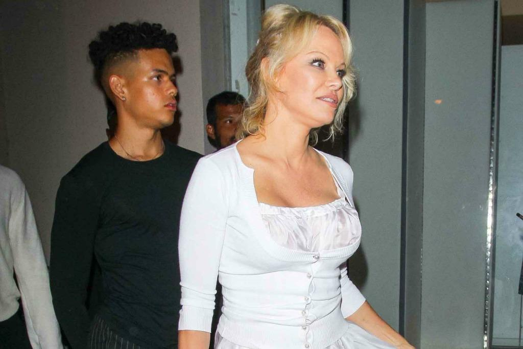 Pamela Anderson Takes a Risk in Revealing White Dress and Black Pumps for Dinner