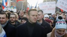 Russian activist Alexei Navalny unconscious after being 'poisoned'