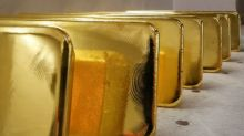 Gold inches up on weak dollar, pandemic peaking hopes cap gains