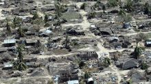 On cyclone-shattered island in Mozambique, shock and debris