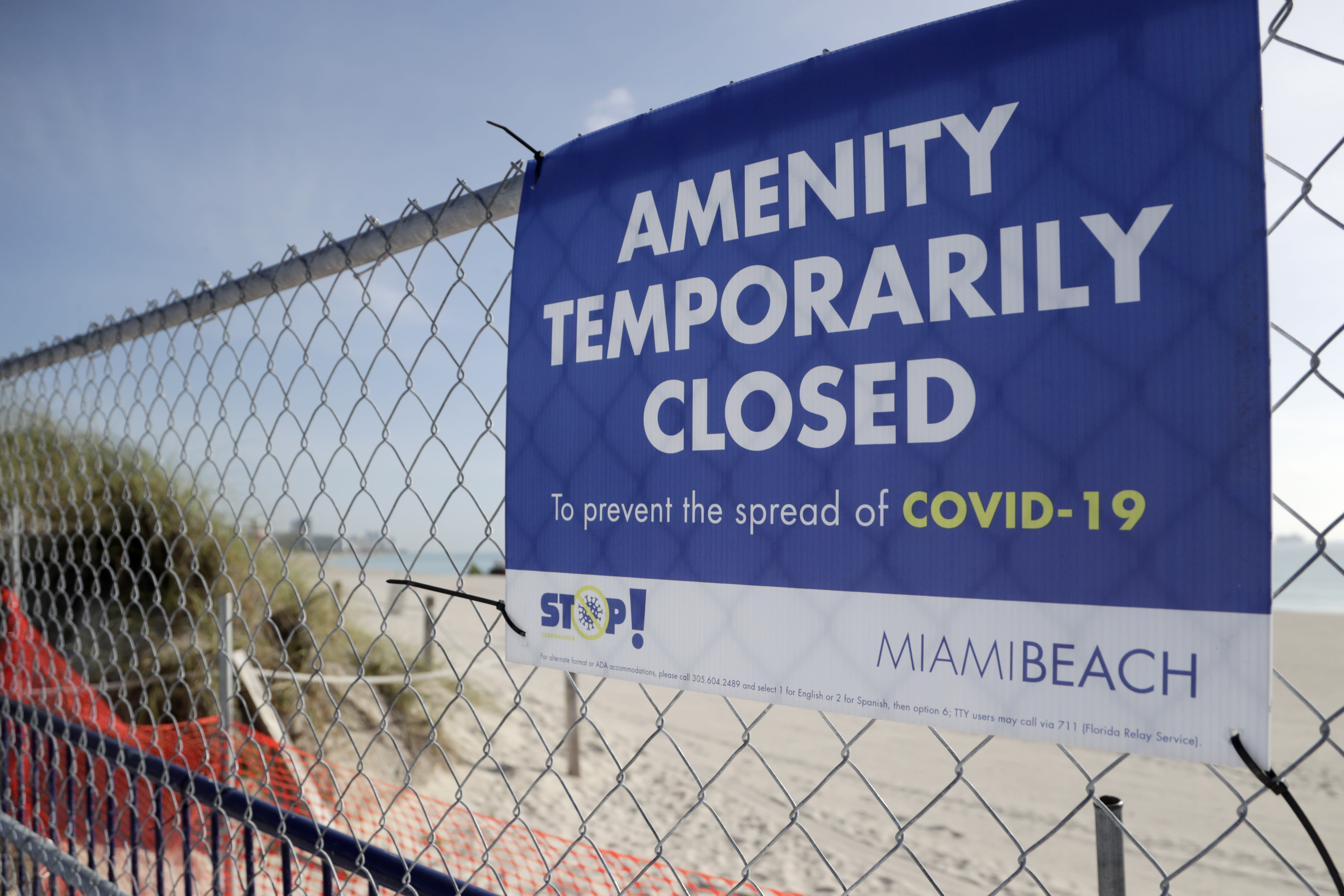 A sign is posted at a closed entrance to the beach during the new coronavirus pandemic, Friday, July 3, 2020, in the South Beach neighborhood of Miami Beach, Fla. Beaches throughout South Florida are closed for the busy Fourth of July weekend to avoid further spread of the new coronavirus. (AP Photo/Lynne Sladky)