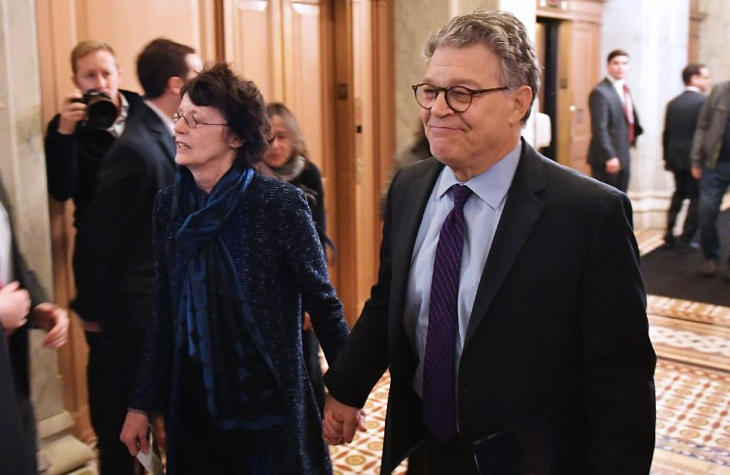 Senator Al Franken, shown with his wife Franni Bryson (L) as they arrived at the US Capitol, has said he will resign in the coming weeks, but added he was shocked at the allegations against him (AFP Photo/MANDEL NGAN)