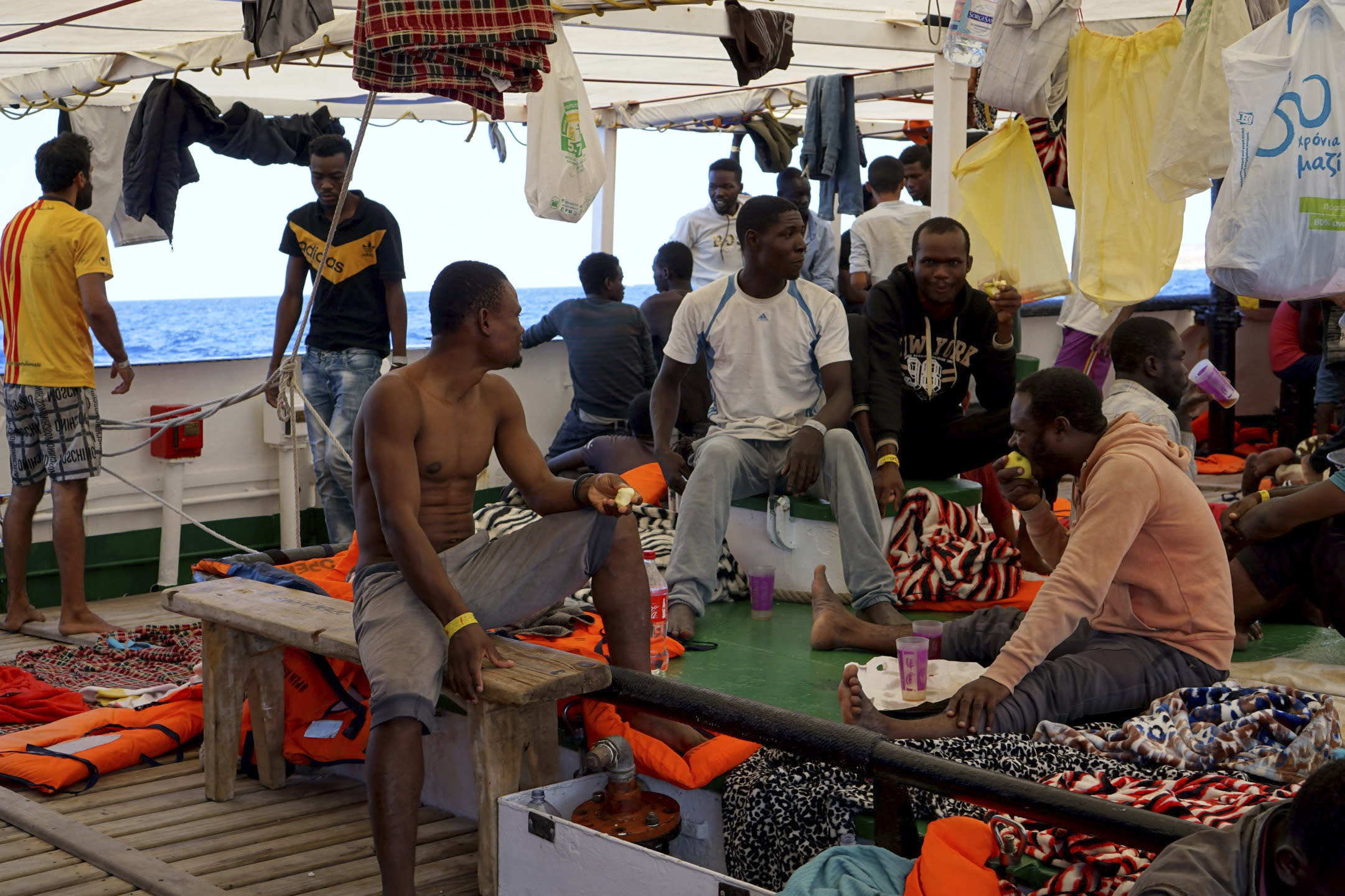 Humanitarian group says stranded migrants are jumping into sea in desperation