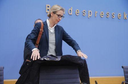Alice Weidel, top candidate of the anti-immigration party Alternative fuer Deutschland (AfD) arrives for a news conference in Berlin, Germany, September 25, 2017. REUTERS/Wolfgang Rattay