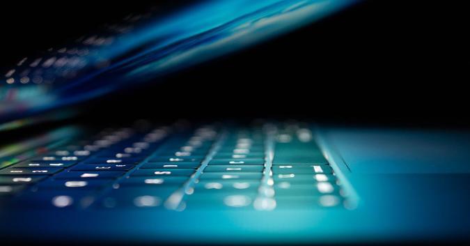 Close-up of a laptop keyboard taken in profile.