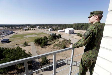 Lithuanian army officer Nerijus Rocevicius looks at construction site of the newly built training premises for urban warfare in Pabrade, Lithuania, April 28, 2016. REUTERS/Ints Kalnins/File Photo