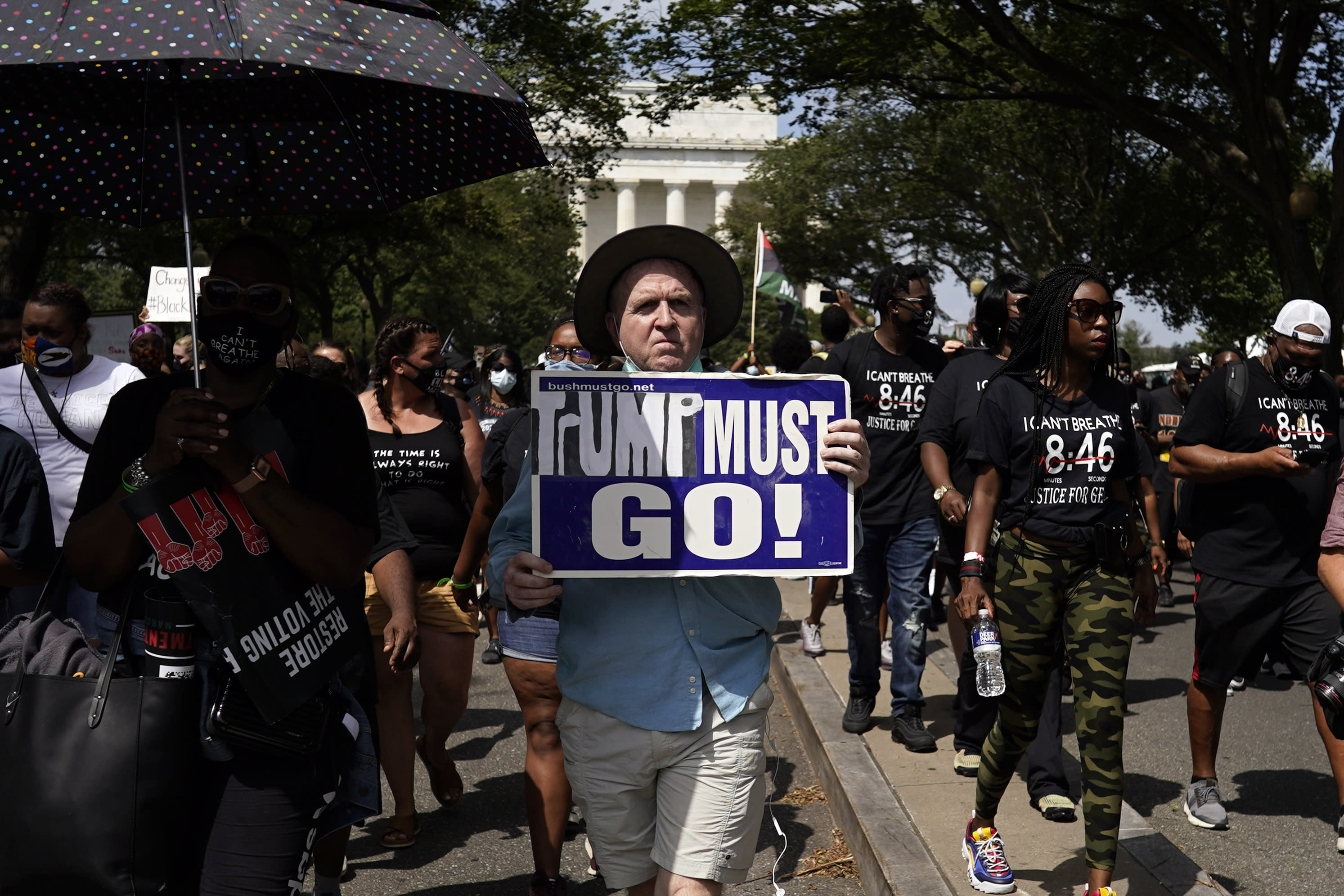 People march from the Lincoln Memorial to the Martin Luther King Jr. Memorial during the March on Washington, Friday Aug. 28, 2020, in Washington. (AP Photo/Carolyn Kaster)