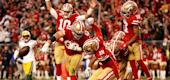 Jimmy Garoppolo (10) and Ben Garland (63) of the San Francisco 49ers celebrate a touchdown by Raheem Mostert. (Getty Images)
