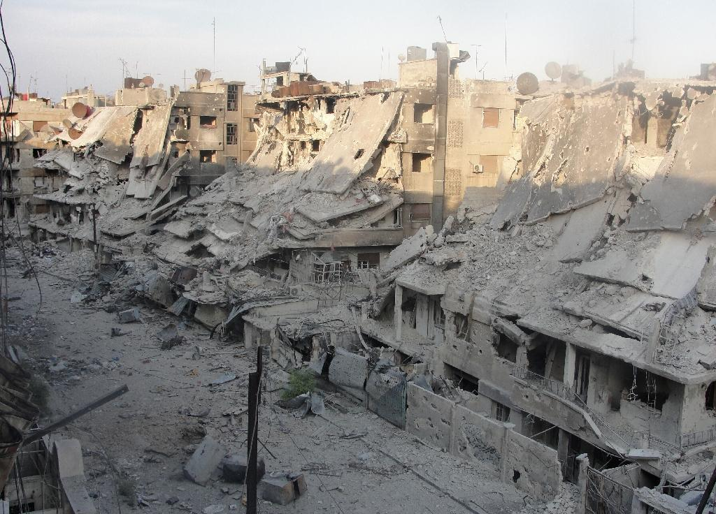 Buildings destroyed in the shelling of a rebel district of Homs are pictured in October 2012 (AFP Photo/)