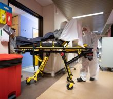 COVID-19 hospitalizations hit new records in 13 states