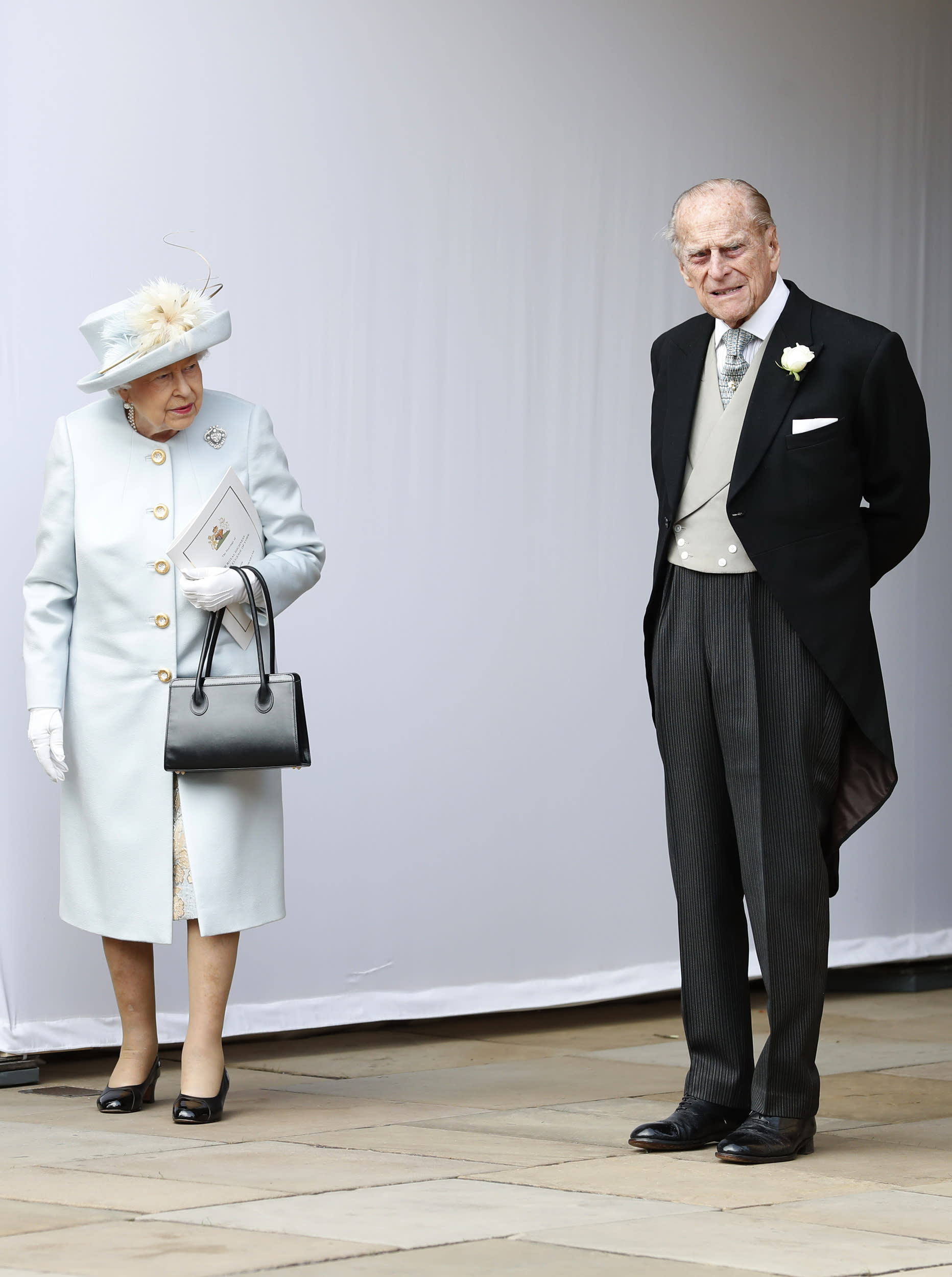 Britain's Queen Elizabeth II, and Prince Philip wait for the arrival by open carriage of Princess Eugenie of York and Jack Brooksbank following their wedding in St George's Chapel, Windsor Castle, near London, England, Friday, Oct. 12, 2018. (AP Photo/Alastair Grant, Pool)