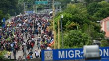 Migrant caravan storms Guatemala border into Mexico