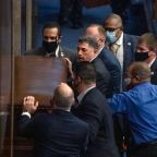 Photo emerges of Republican barricading chamber doors during US Capitol attack after he compared rioters to 'tourists'