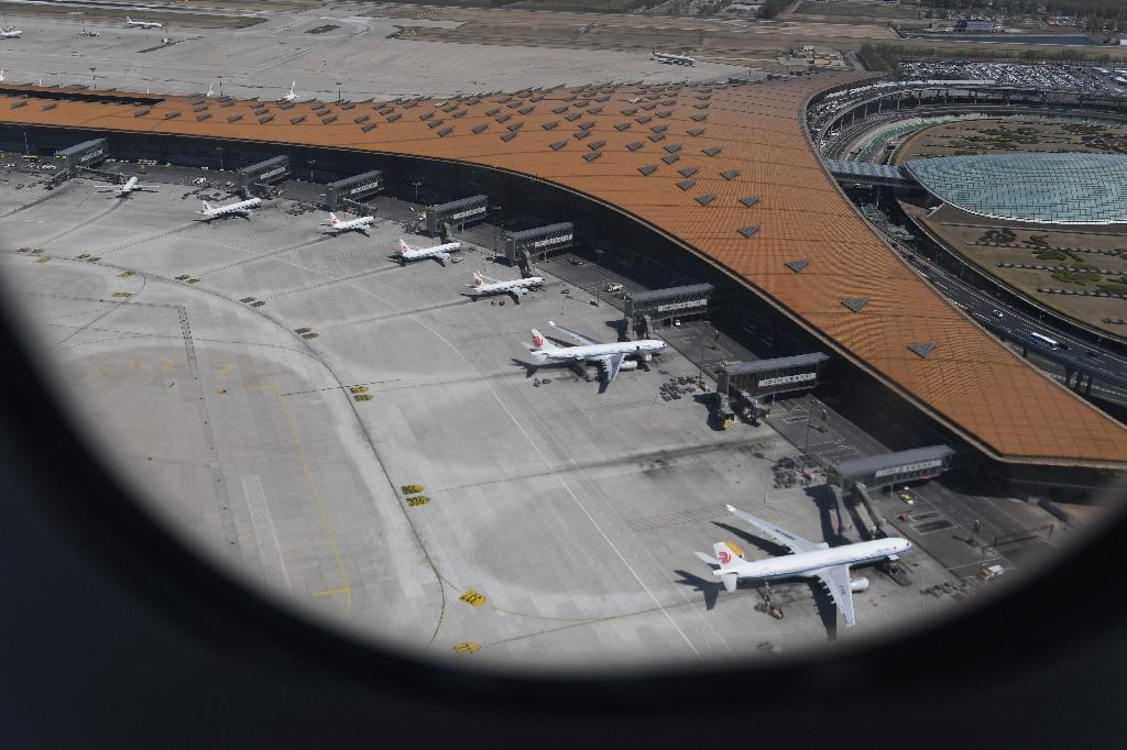 Various Airbus A330 and Boeing 737 planes of Air China parked at Beijing's capital airport (AFP Photo/GREG BAKER)