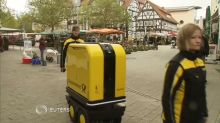 German postal workers get a helping hand from a rolling robot