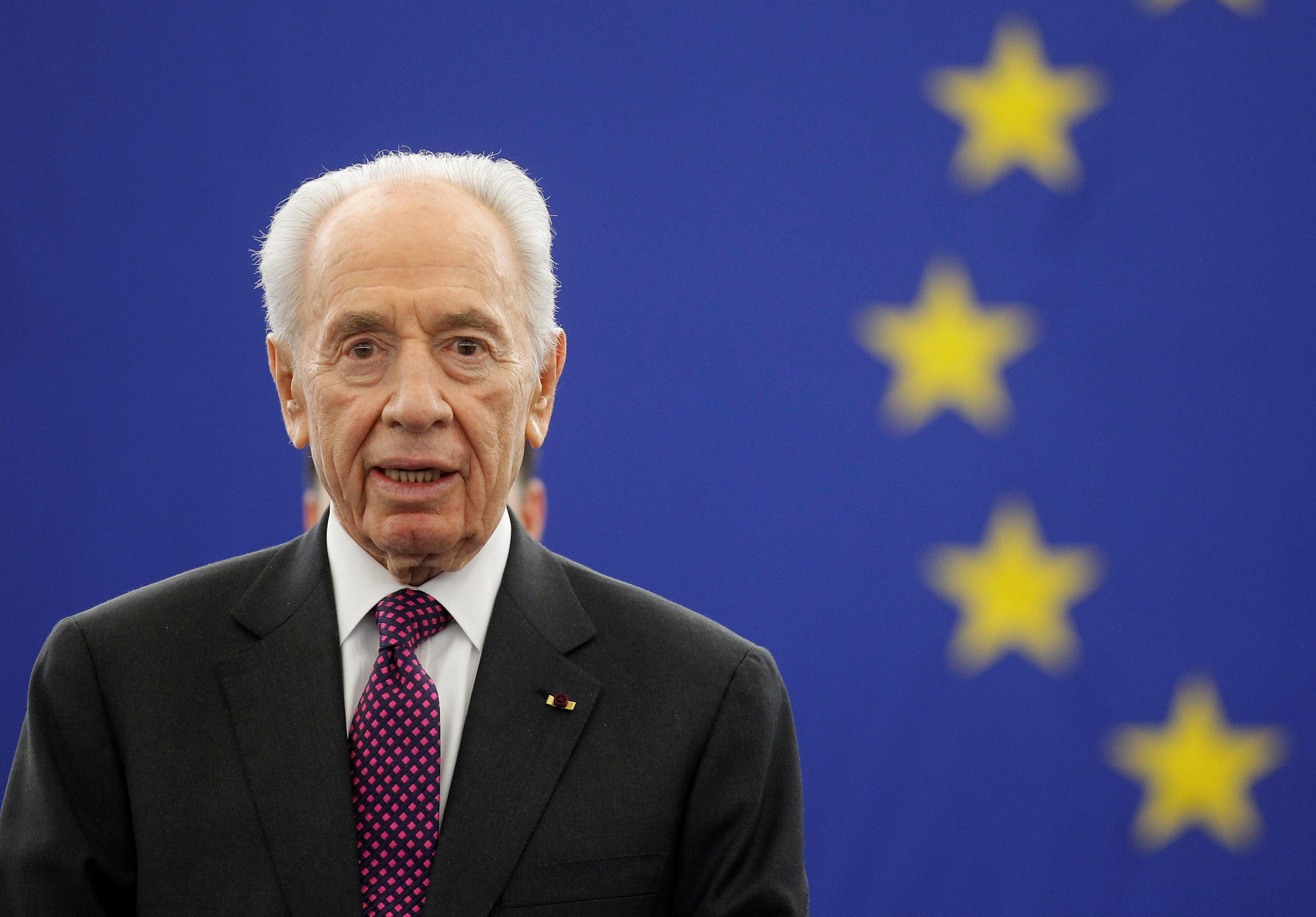 Israel's President Shimon Peres addresses the European Parliament in Strasbourg, in this March 12, 2013 file photo. REUTERS/Jean-Marc Loos/Files