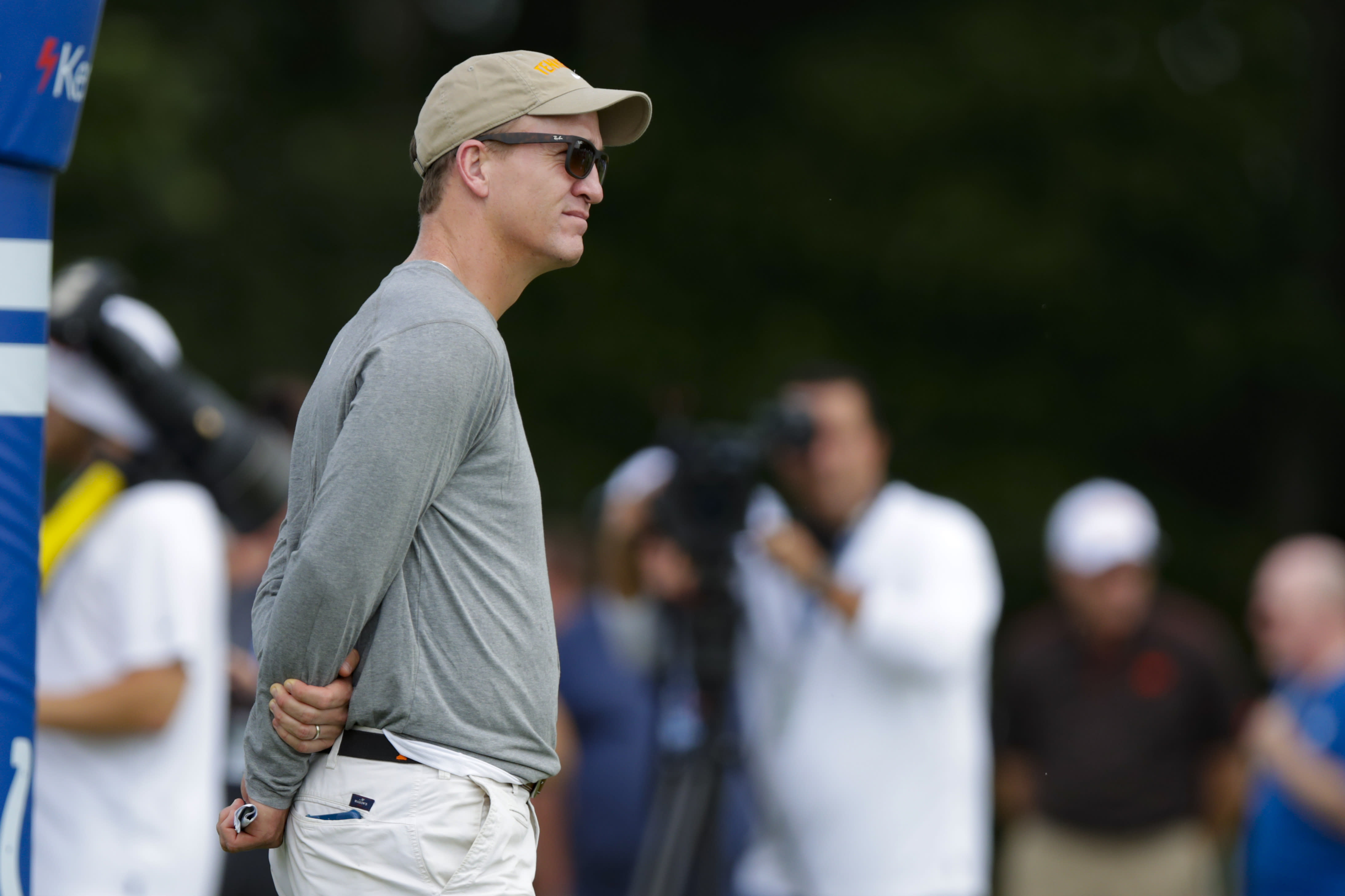 Former Indianapolis Colts quarterback Peyton Manning watches a joint practice of the Cleveland Browns at the Colts' NFL football training camp in Westfield, Ind., Thursday, Aug. 15, 2019. (AP Photo/Michael Conroy)