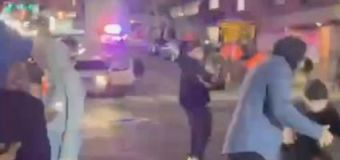 Police car barrels into crowd watching street races